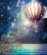 Hot fire balloon in the starry sky