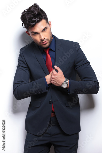 business man searches in his chest pocket