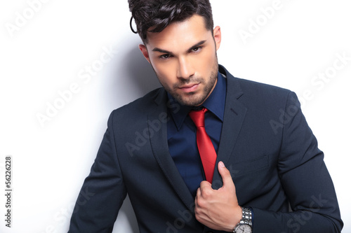 closeup of business man with hand on lapel
