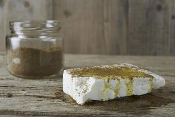 Fresh feta cheese full of olive oil and oregano vase