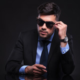 young business man with hand on sunglasses