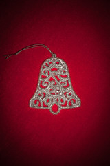 christmas silver bell on red