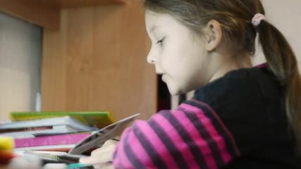 schoolgirl does his homework, close-up