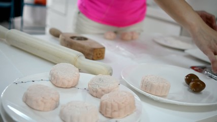 Asian Chinese Woman preparing traditional moon cakes