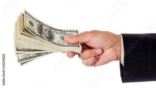 man's hand giving pack of dollars