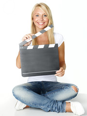 Girl with clapperboard: On your marks, get set, go!