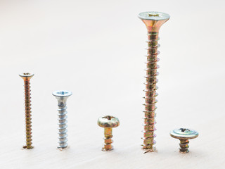 range of screws wrapped in wooden plank