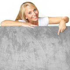 Blonde woman with message board
