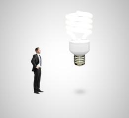 man looking on energy lamp
