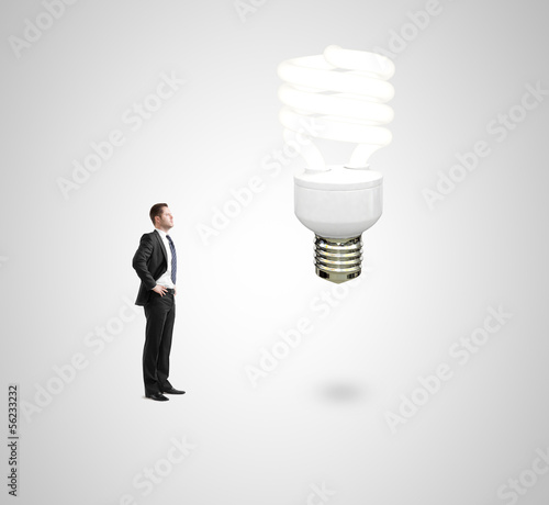 man looking on energy lamp