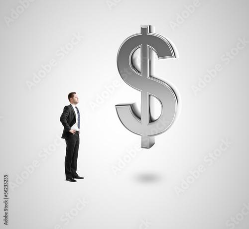 man looking at dollar