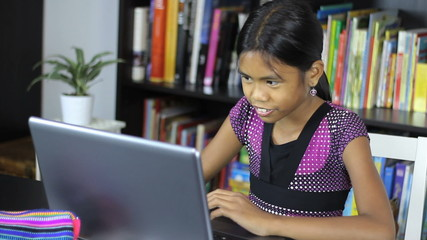 Young Asian Girl Using Her Laptop Computer