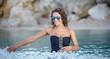 Beautiful sexy woman in bikini posing in water