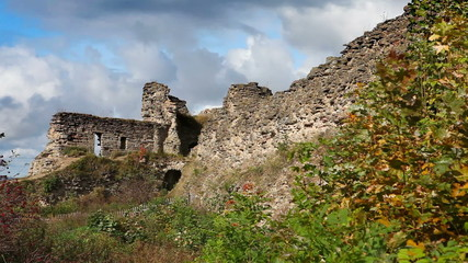 Autumn trees at the ancient destroyed fortress. Russia.