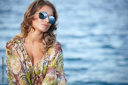 young beautiful girl in dress on the coast