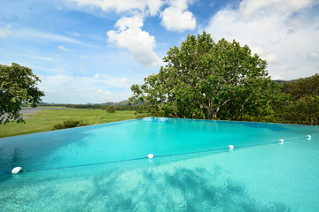 Infinity swimming pool in beautiful landscape
