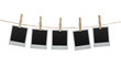 Blank photos hanging on the clothesline