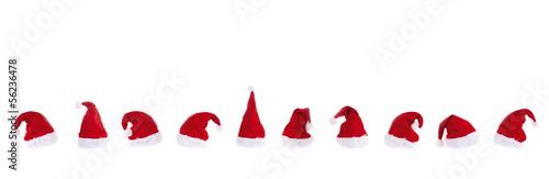 Leinwandbild Motiv Nikolausmützen in der Reihe