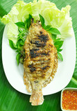 fish grilled with salt in plate , Thai food style