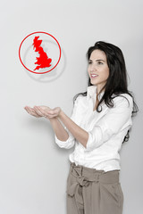 Woman holding a map of the UK