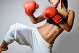 Fototapety beautiful woman with the red boxing gloves, studio shot