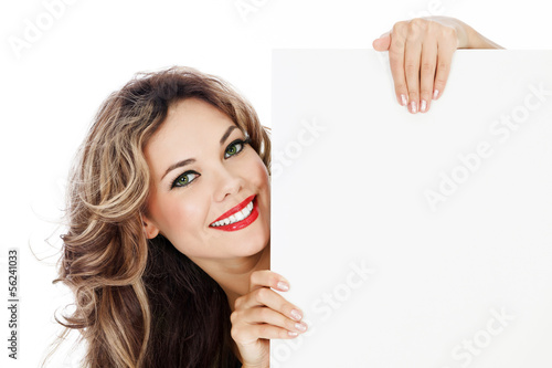 Young smiling woman shows blank card.