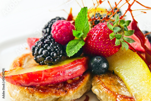 Dessert with baked apples and fresh berries