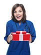 Surprised young nurse holding a gift box. Isolated on white back