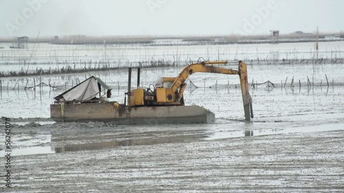 Yellow Excavator in the wetlands