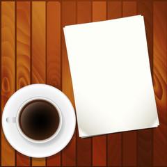 чашка кофе и листы бумаги на столе