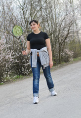 Woman standing with a badminton racket