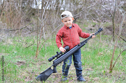 Little boy with a rifle