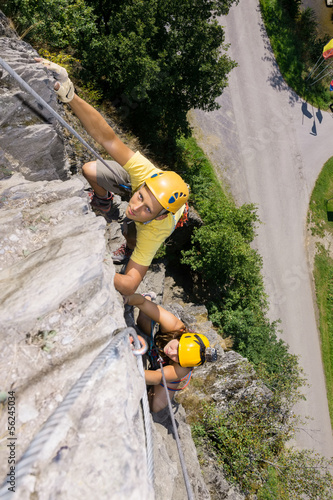Man And Woman Climbing Rock