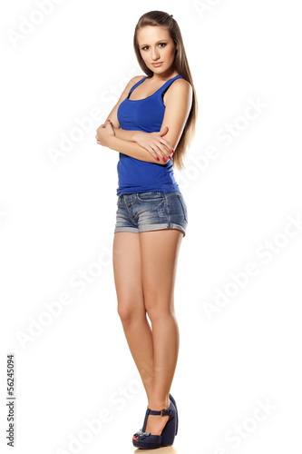 attractive girl in a short jeans posing with crossed arms