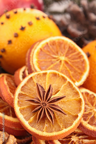 close up on star anise and dried orange slices