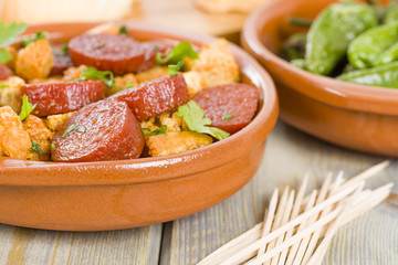 Chorizo & Bread and Padron Peppers Tapas - Spanish tapas dishes.