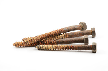 four rusty screws on a white