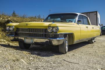 yellow cadillac car