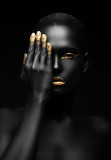 dark-skinned woman with golden make-up. - 56248061