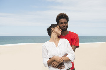 Multiethnic couple on the beach