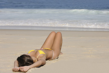 Sexy woman lying on the beach
