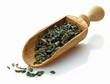 wooden scoop with green tea  camellia sinensis