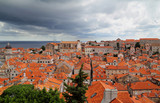 Old town in city of Dubrovnik with whirlwind at sea
