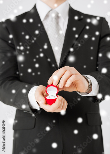man with gift box and wedding ring