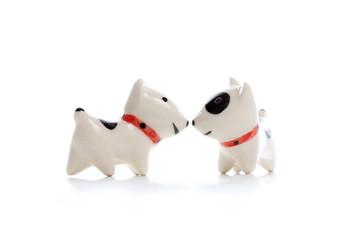 two Dog Figurine on White Background