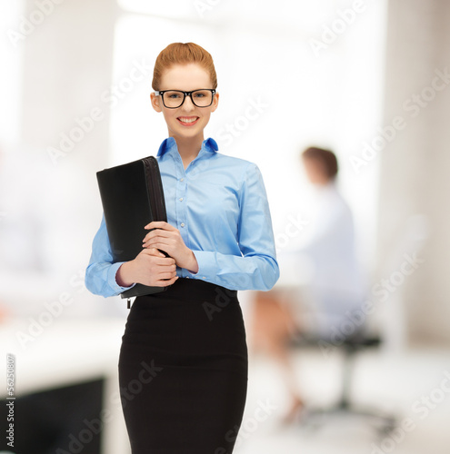 smiling woman with folder