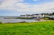 Leinwandbild Motiv View of harbour and town Port Charlotte on Isle of Islay