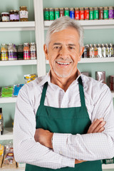 Confident Male Owner Standing In Grocery Store