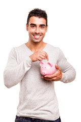 Man saving money to a piggy bank