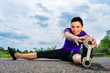 Sports outdoor - young woman doing fitness in park
